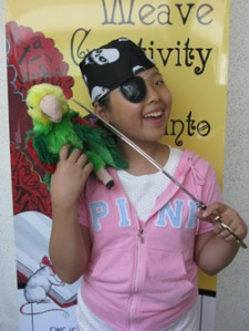 The Pirate Golden Tooth with her pet, Squawky
